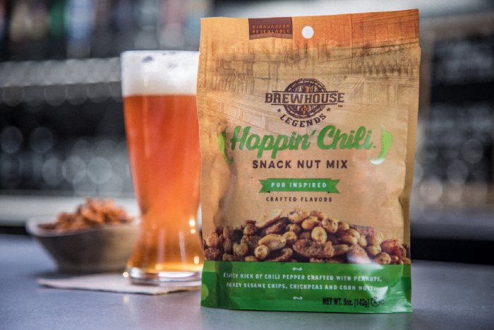 brewhouse legends hoppin chili' bag on bar with beer