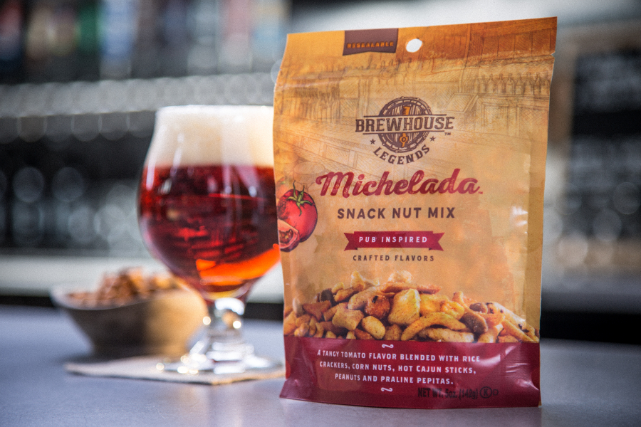 brewhouse legends snack mixes michelada flavor 5 oz bag on bar with beer
