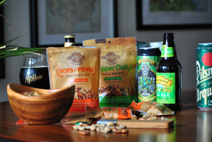 brewhouse legends hops and pepper and hoppin' chili on a table with beer
