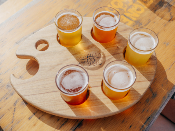 five beers in a flight on a table